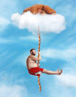 Fat man hanging on sausage rope