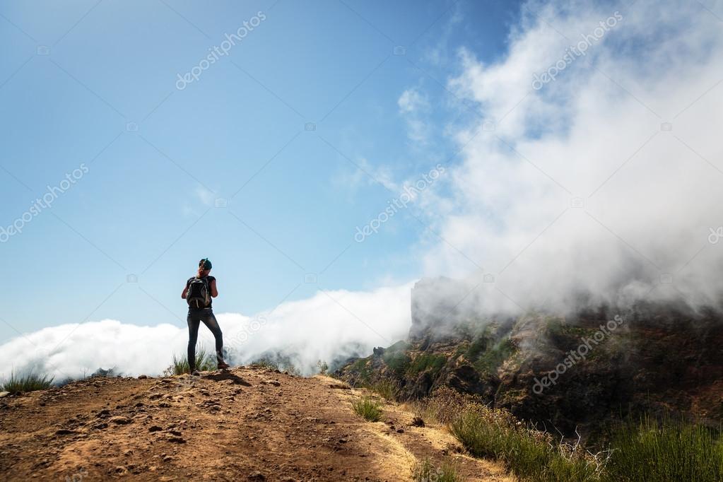 Hiking girl Traveler in mountains