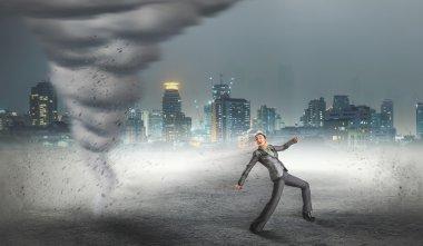 running Businesswoman with tornado