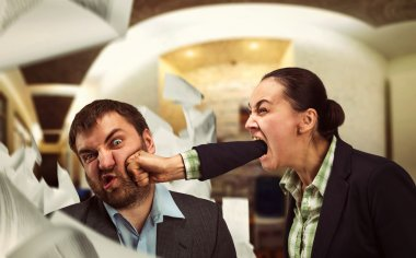 Businesswoman shouts at young businessman and beats him stock vector