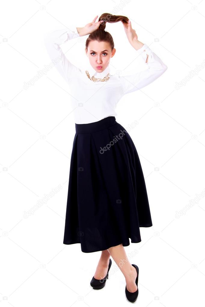673ec28cf13d08 Mooie jonge vrouw in een witte blouse en een lange zwarte rok geïsoleerd op witte  achtergrond — Foto van ...