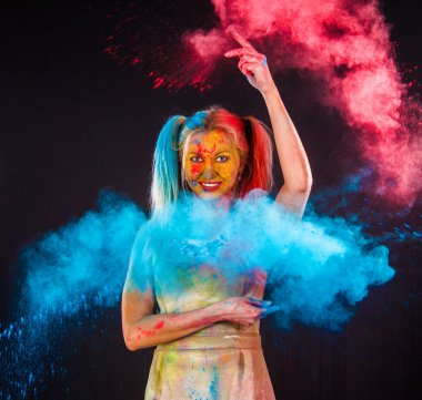 Young woman covered with paints