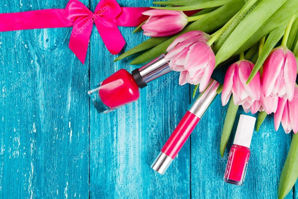 Beautiful pink tulips on blue wood background