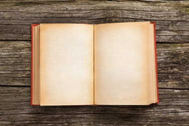 Old open book on wooden background stock vector
