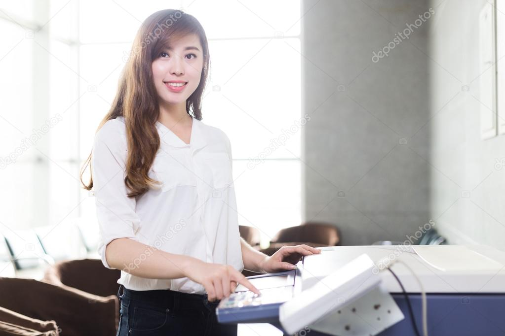 asian girl press button of copier