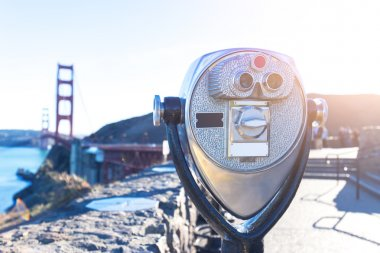 camera with Gold Gate Bridge over water