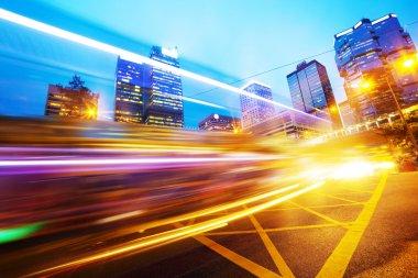 Traffic light trails in modern business city