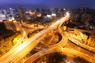 Modern city traffic and skyline at night Shanghai.