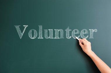 volunteer written on blackboard