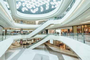 abstract ceiling and escalators in hall of shopping mall
