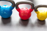 colorful kettlebells in gym or sport club