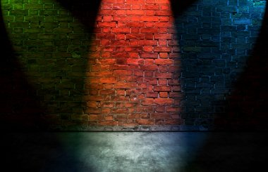 Colorful spot lights on brick wall