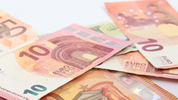 euro bills falling on the table surface