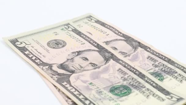 paper bills of dollars fall on the table surface when giving a bribe