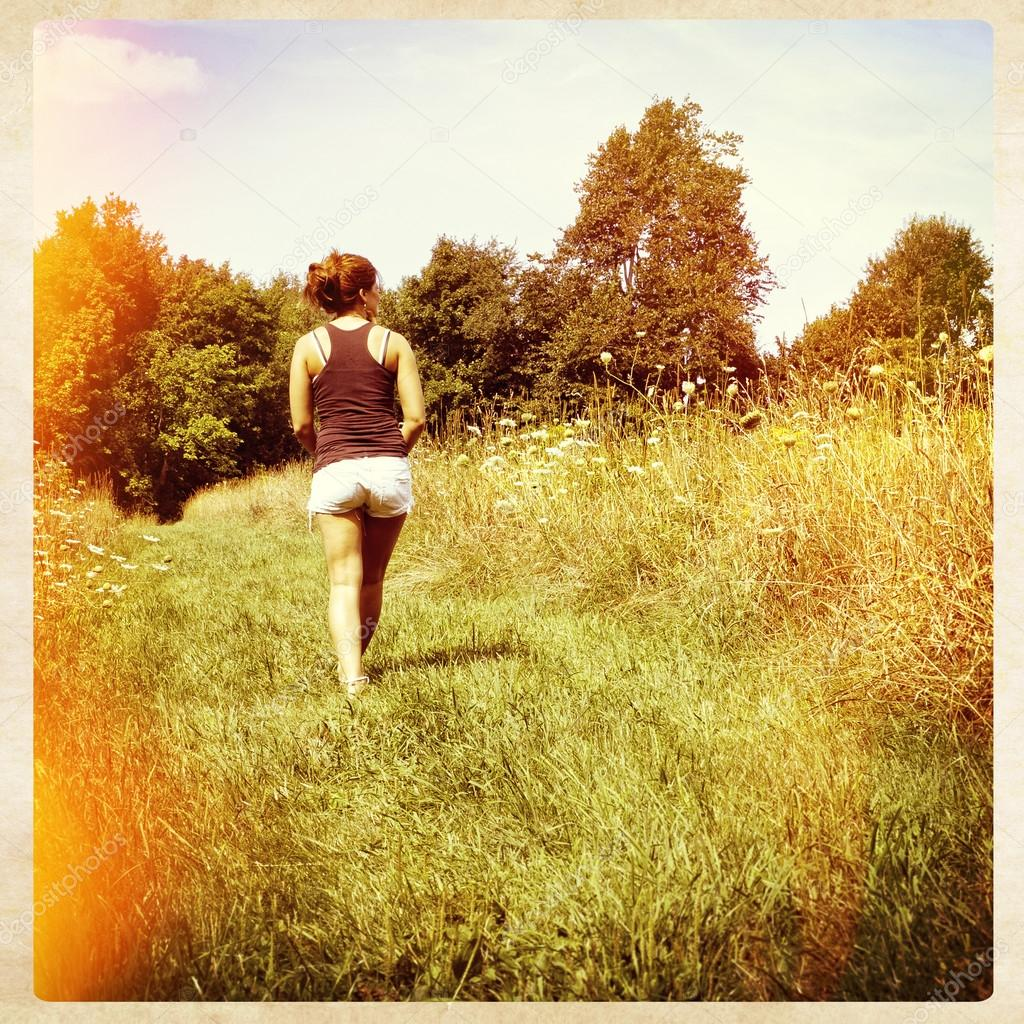 Woman walking away in nature