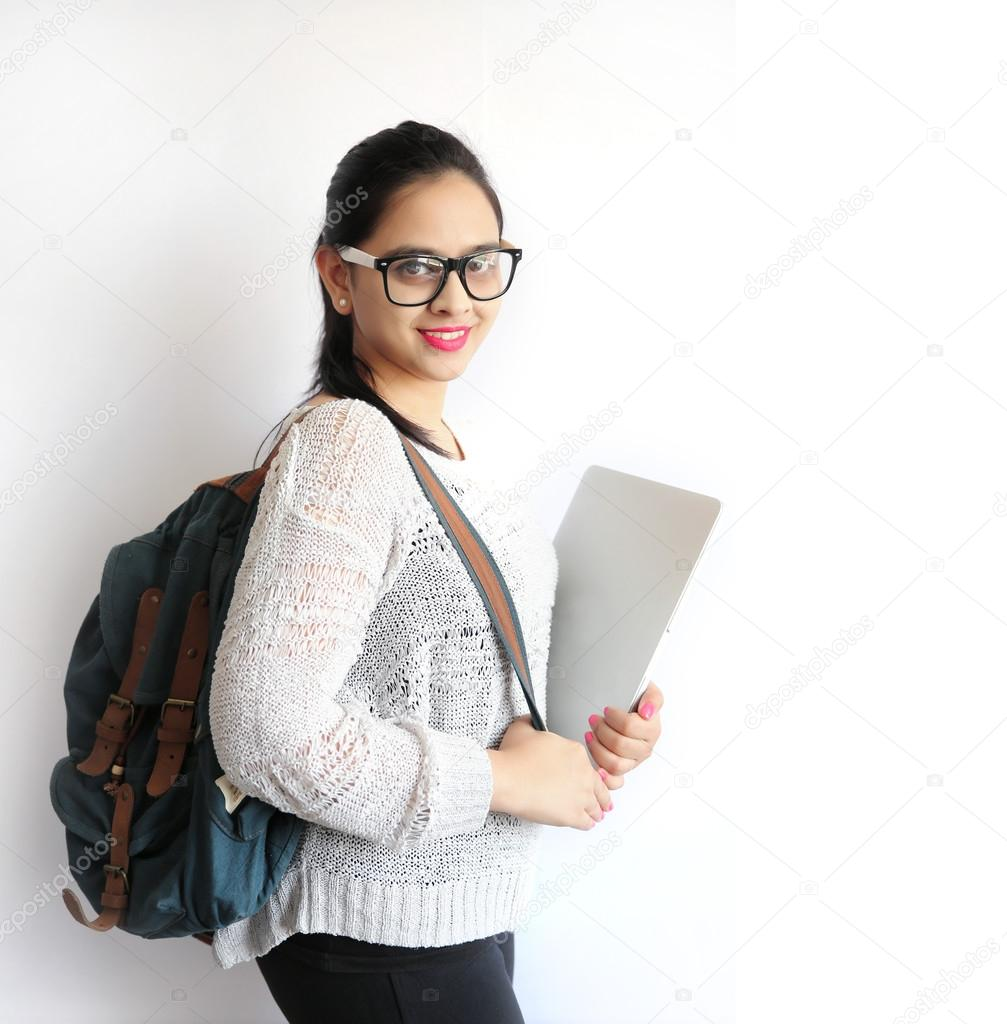 A Young Beautiful Indian College Student Holding Laptop on