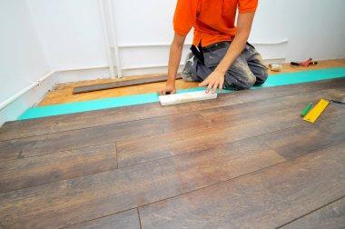 Carpenter doing laminate floor work