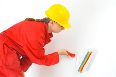 Real female painter renovating her apartment