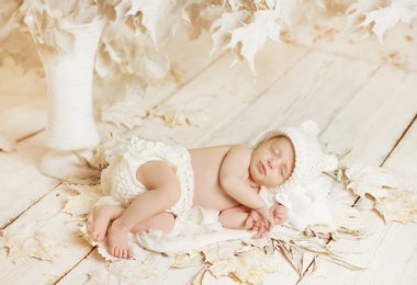 Newborn Sleeping Baby Portrait, New Born Little Child Lying On Autumn White Art Leaves, Dreaming Bedtime Story