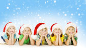 Fotografie Christmas Children In Santa Helper Hat, Little Kids Boys and Girls Happy Greeting Xmas Holiday