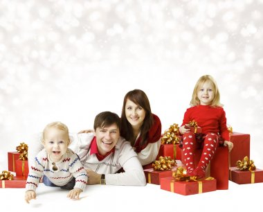 Christmas Family Portrait Over White Background, Kid and Baby With New Year Present Gift Box