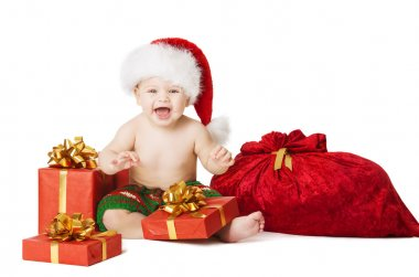 Christmas Baby Kids, Present Gift Box And Santa Bag, Child Happy Smiling In Red Hat With Xmas Sackful, Isolated White Background