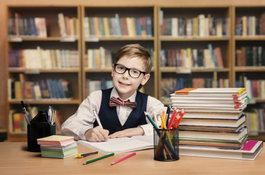 School Kid Studying in Library, Child Writing Book