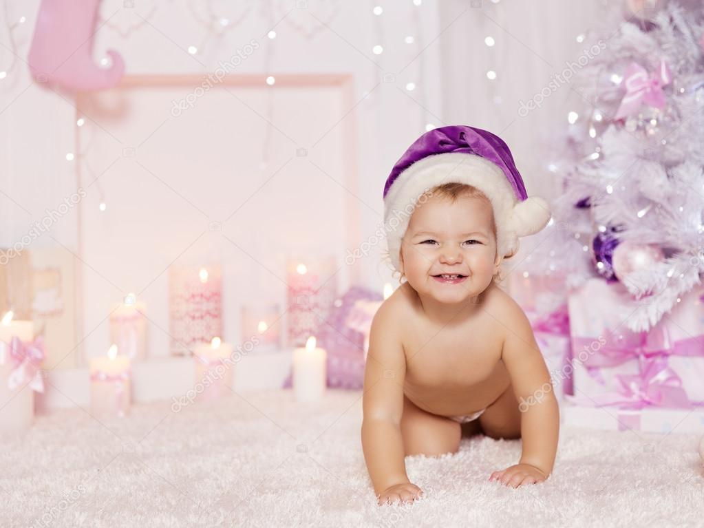 Christmas Baby in Santa Hat, Kid Pink Decorated Xmas Room
