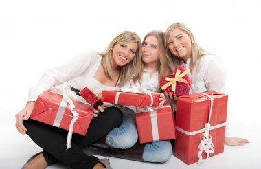Three happy sisters with presents
