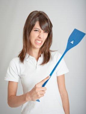 Girl with flyswatter