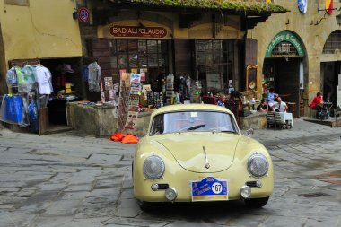 A yellow Porsche 356 A takes part to the GP Nuvolari classic car race on September 20, 2014 in Arezzo. The car was built in 1957