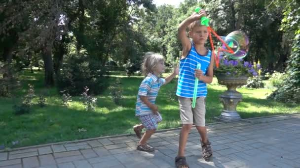 children playing with big soap bubbles in the park