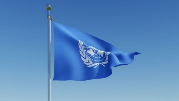Flag of the United Nations waving against blue sky.
