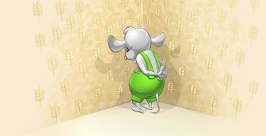 Little mouse standing in a corner