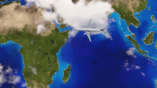 Letadlo letící nad mraky nad mapu země