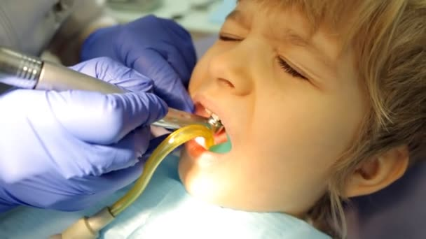 Kid during procedure of teeth treatment at dentist clinic office