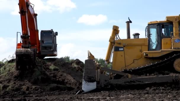 Bulldozer tractor works at moving soil and rock.