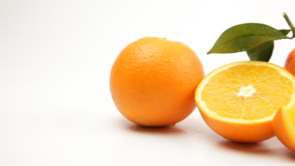 Ripe juicy oranges on a white background