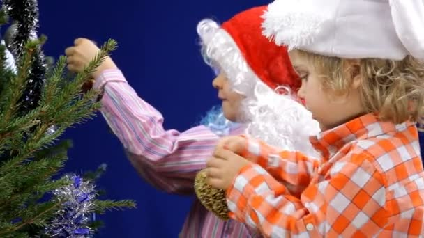Adorable little kids decorating Christmas tree