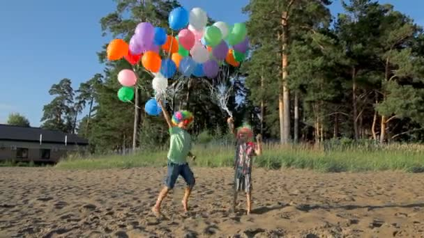kids having fun jumping and dancing with balloons