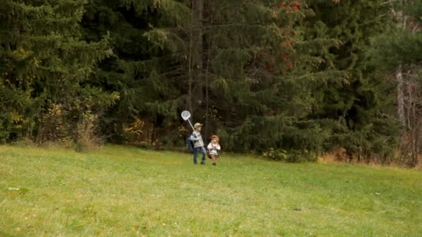 Two boys walking in adventure, paths , kids hiking with backpacks.