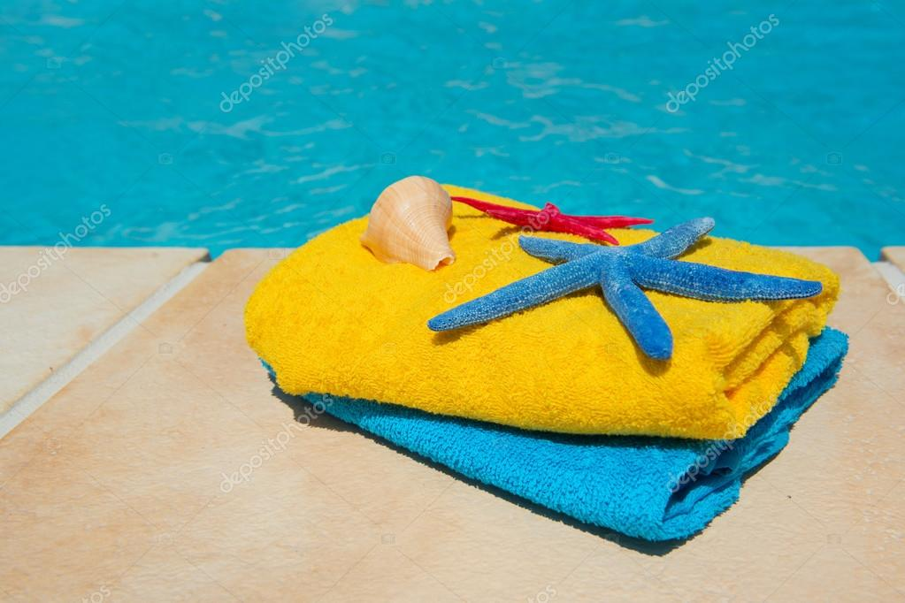 Towels at the swimming pool — Stock Photo © ivonnewierink ...