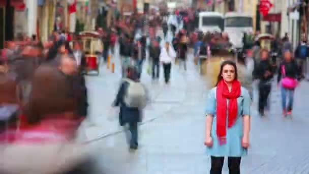 Woman posing on busy street, timelapse