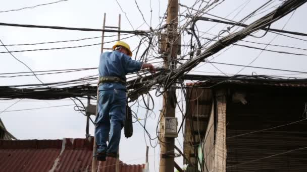 Electrician fixing electric cables