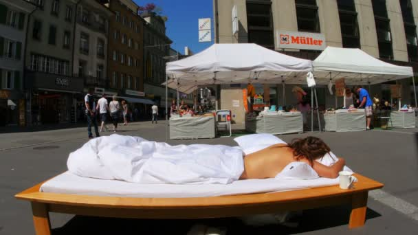 Sleeping performance, public nudity festival