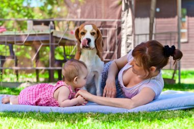 grandmother with dog and granddaughter