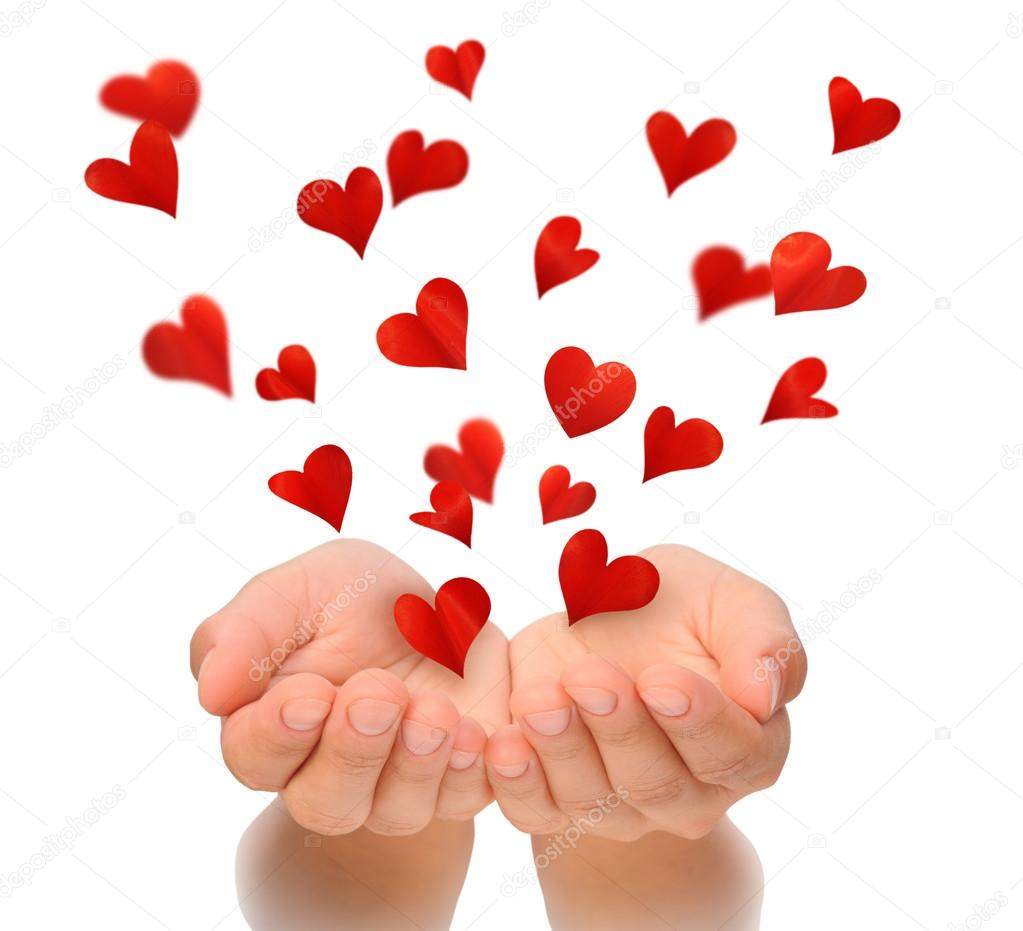 Flying Hearts From Cupped Hands Of Young Woman Valentine S Day