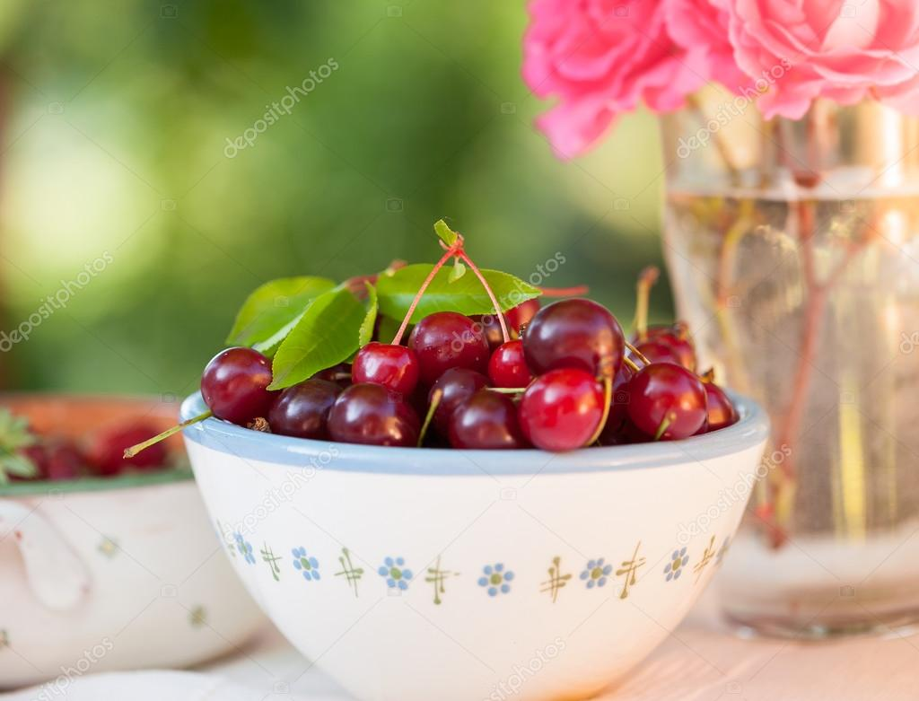Sour cherry and strawberry in bowls