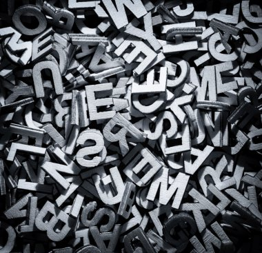 Monochrome letters in a pile