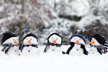 Cute snowman group in snow